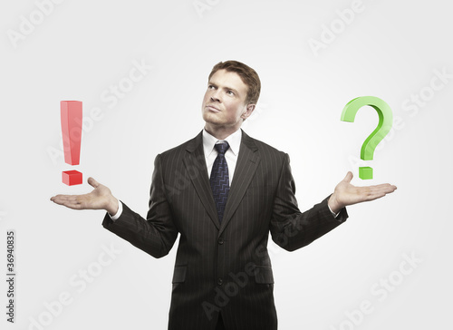 Businessman with a question and exclamation mark