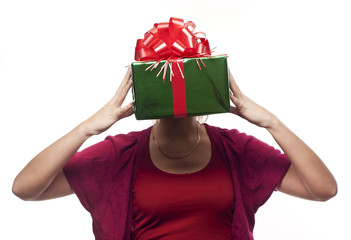 Young beautiful woman with a present gift over her face