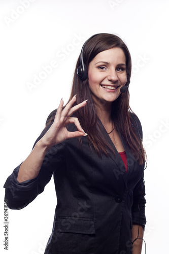 Smiling woman operator with headset showing hand ok sign