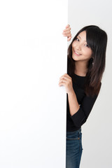 pretty asian woman with blank whiteboard