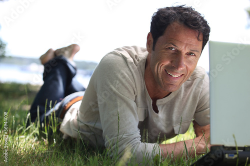 Man smiling working on the grass