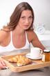 brunet having breakfast in bed