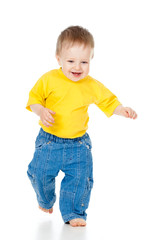 Fun baby boy running. Studio shot.