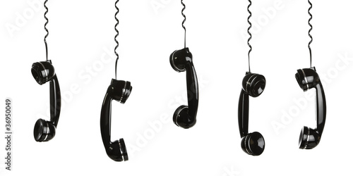 Rotary telephone handsets hanging in the air isolated on white - 36950049