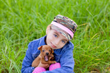 little girl with pet puppy mascot mini pinscher