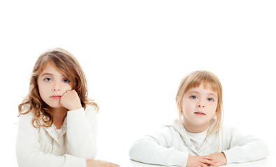 blond and brunette kid girls portrait on white