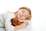 blond kid girl sleeping with mini pinscher pet