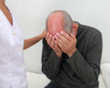 Male patient being comforted - soft blur