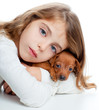 brunette kid girl with mini pinscher pet mascot dog