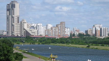 Rowing competition in front of tall buildings in Moscow