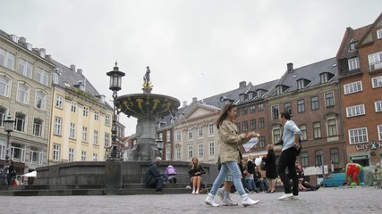 People relax in front of  fountain