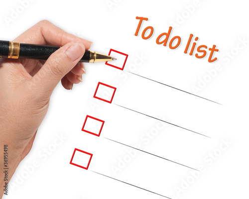 female hand checking to do list