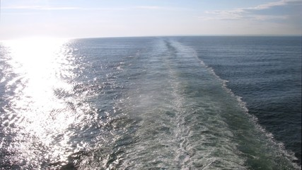 Cruise liner trace on cloudy day, view from ship stern