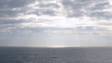 Light pass through clouds at sea, view from ship, time lapse