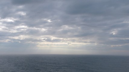 Beautiful skies above calm sea, view from ship, time lapse