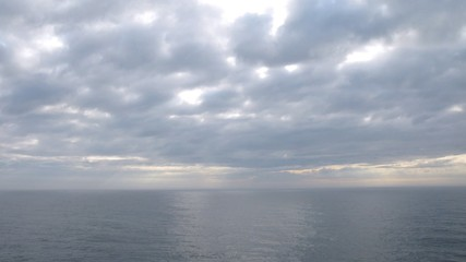 Beautiful evening skies above calm sea, time lapse