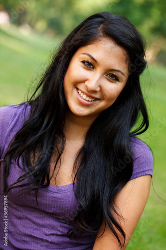 Portrait of young Asian Hispanic woman at the park