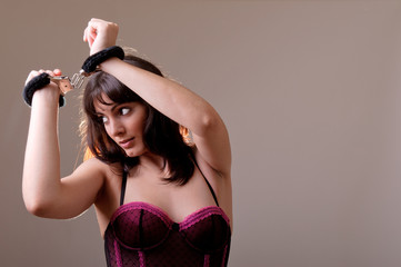 sensual woman wearing a corset and handcuffs