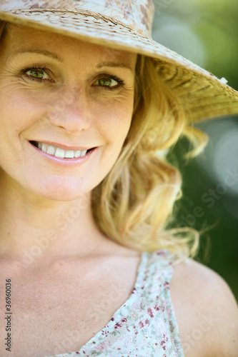 Wife wearing straw hat.
