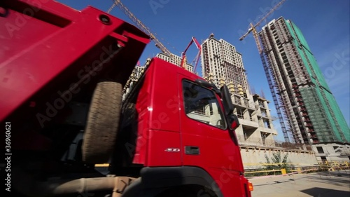 tipper ride on road in front of houses construction site