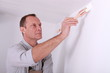 Man repainting home walls