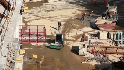 Several worker in action on construction site
