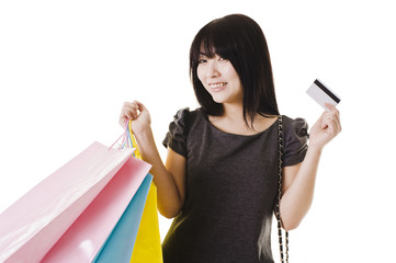 Chinese woman holding shopping bags and credit card.