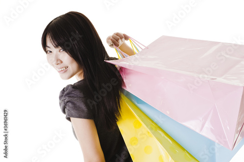 Chinese woman holding shopping bags.