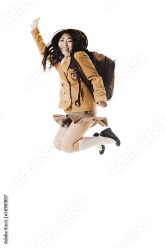 Chinese school girl jumping in the air.