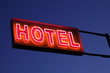 Hotel sign illuminated at night