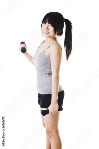 Chinese girl lifting hand weights.