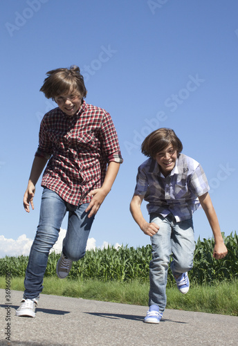 happy kids running on a road