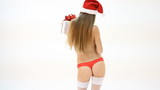 nude christmas woman in santa hat with gift box dancing
