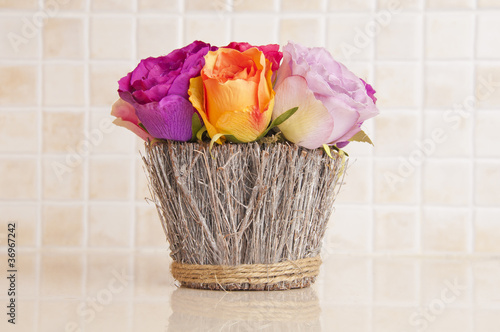 Fake flowers on the kitchen bench