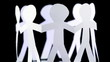 eight paper people stand in circle and hold hands, rotates