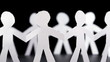 paper people stand in circle and hold hands, rotates on black