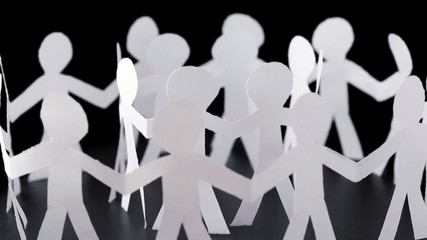 paper people stand in two circles and hold hands, rotates