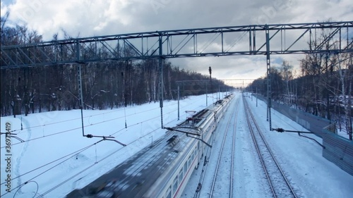 High-speed train is approaching and passes, at winter