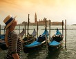 Beautiful woman in hat against Venice panorama