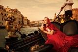 Fototapety Beautifiul woman in red cloak riding on gandola