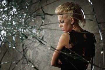 Punk girl behind broken glass