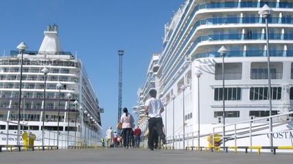 Two cruise liners stationed at bay