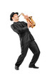 Portrait of a man in a suit playing on saxophone