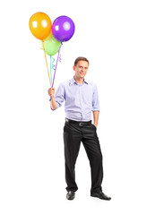 Full length portrait of a smiling man holding balloons