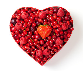 Red berries for  in heart-shaped box