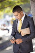 Businessman sending messages at the cellular