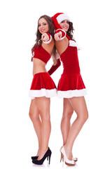 two sexy santa women pointing