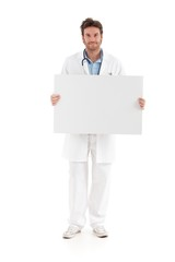 Casual doctor holding blank sheet smiling