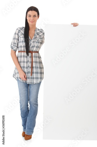 Attractive woman with blank sheet smiling