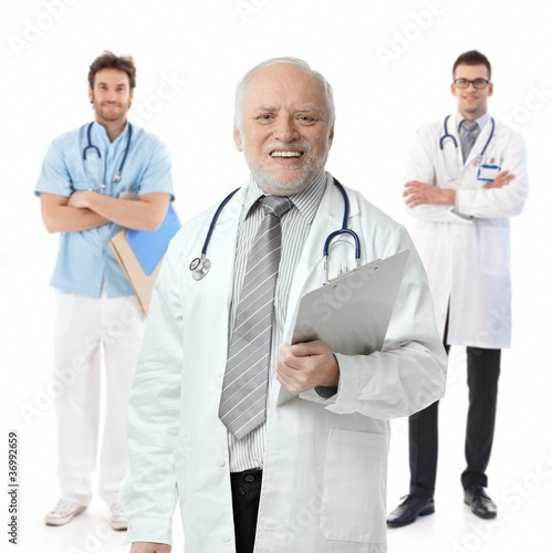 Doctors standing on white background, portrait
